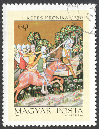chronicle: MOSCOW, RUSSIA - CIRCA JUNE, 2016: a post stamp printed in HUNGARY shows The Pursuit of King Peter, the series Miniatures from Chronicle of King Lajos I, circa 1971