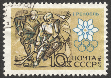 olympic games: MOSCOW, RUSSIA - CIRCA JUNE, 2016: a post stamp printed in the USSR shows hockey players, the series Winter Olympic Games - Grenoble 1968, France, circa 1967