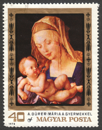 albrecht: MOSCOW, RUSSIA - CIRCA JUNE, 2016: a post stamp printed in HUNGARY shows the painting Virgin and Child, the series The 450th Death Anniversary of Durer, circa 1979