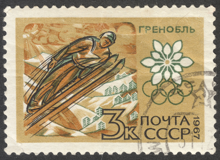 olympic ring: MOSCOW, RUSSIA - CIRCA JUNE, 2016: a post stamp printed in the USSR shows a flying skier, the series Winter Olympic Games - Grenoble 1968, France, circa 1967