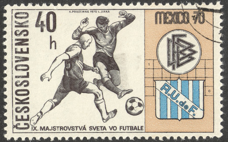 football world cup: MOSCOW, RUSSIA - CIRCA JUNE, 2016: a post stamp printed in CZECHOSLOVAKIA shows Two Players and Badges of Germany and Uruguay, the series Football World Cup - Mexico, circa 1970