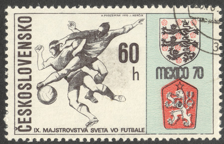 football world cup: MOSCOW, RUSSIA - CIRCA JUNE, 2016: a post stamp printed in CZECHOSLOVAKIA shows Two Players and Badges of England and Czechoslovakia, the series Football World Cup - Mexico, circa 1970 Editorial