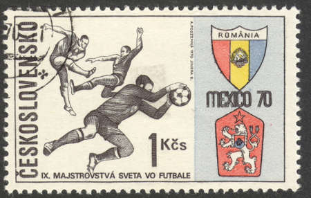 football world cup: MOSCOW, RUSSIA - CIRCA JUNE, 2016: a post stamp printed in CZECHOSLOVAKIA shows Three Players and Badges of Romania and Czechoslovakia, the series Football World Cup - Mexico, circa 1970
