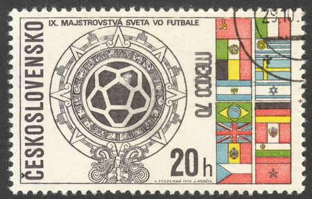 football world cup: MOSCOW, RUSSIA - CIRCA JUNE, 2016: a post stamp printed in CZECHOSLOVAKIA shows World Cup Emblem and Flags, the series Football World Cup - Mexico, circa 1970