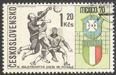 football world cup: MOSCOW, RUSSIA - CIRCA JUNE, 2016: a post stamp printed in CZECHOSLOVAKIA shows Three Players and Badges of Brazil and Italy, the series Football World Cup - Mexico, circa 1970 Editorial