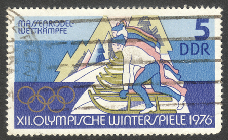 ddr: MOSCOW, RUSSIA - CIRCA JUNE, 2016: a post stamp printed in DDR, the series Winter Olympic Games - Innsbruck, Austria, circa 1975