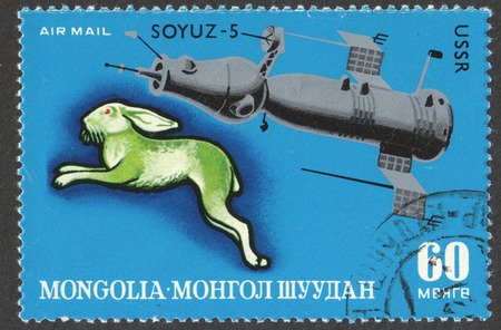 chinese postage stamp: MOSCOW, RUSSIA - CIRCA JUNE, 2016: a post stamp printed in MONGOLIA shows Hase and Soyuz-5, the series Zodiac Pictures Of The Lunisolar Calendar And Space, circa 1972