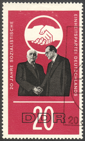 ddr: MOSCOW, RUSSIA - CIRCA JULY, 2016: a stamp printed in DDR shows W. Pieck and O. Grotewohl, the series The 20th Anniversary of the Socialist Unity Party, circa 1966 Editorial