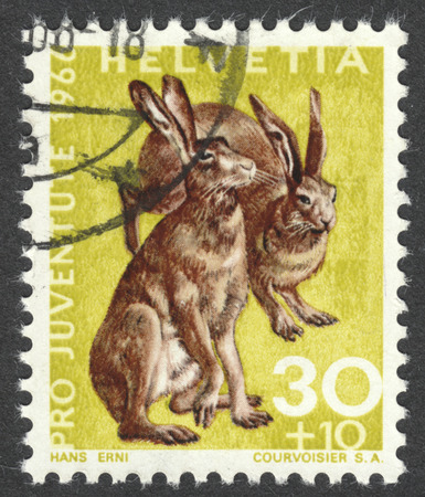 MOSCOW, RUSSIA - CIRCA JULY, 2016: a post stamp printed in SWITZERLAND shows rabbits (Lepus europaeus), the series Pro Juventute - Wild Animals, circa 1966