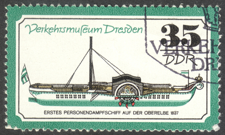 steamboat: MOSCOW, RUSSIA - CIRCA JUNE, 2016: a post stamp printed in DDR shows a personal steamboat, the series Transportation - Dresden Traffic Museum, circa 1977