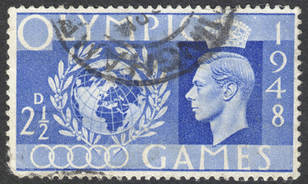 wembley: MOSCOW, RUSSIA - CIRCA AUGUST, 2016: a stamp printed in the UNITED KINGDOM shows a globe and laurel wreath, dedicated to the Olympic Games, circa 1948 Editorial
