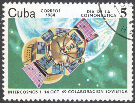 cosmonautics day: MOSCOW, RUSSIA - CIRCA AUGUST, 2016: a stamp printed in CUBA shows Intercosmos 1 (1969), the series Cosmonautics Day, circa 1984 Editorial
