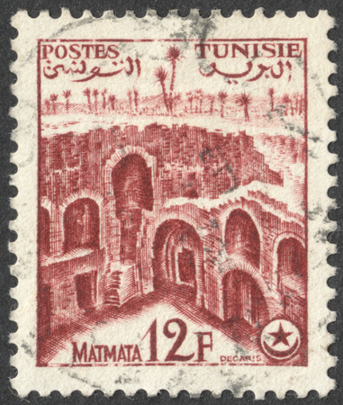 matmata: MOSCOW, RUSSIA - CIRCA AUGUST, 2016: a stamp printed in TUNISIA shows Matmata, the series Tourism, circa 1954