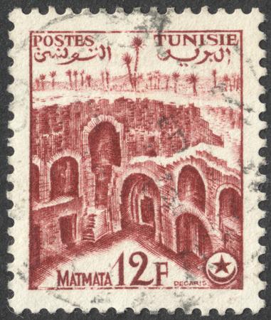 matmata: MOSCOW, RUSSIA - CIRCA AUGUST, 2016: a stamp printed in TUNISIA shows Matmata, the series Tourism, circa 1954