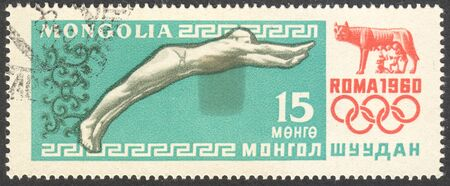 timbre: MOSCOW, RUSSIA - CIRCA AUGUST, 2016: a stamp printed in MONGOLIA shows diving, the series Olympic Games - Rome, Italy, circa 1960