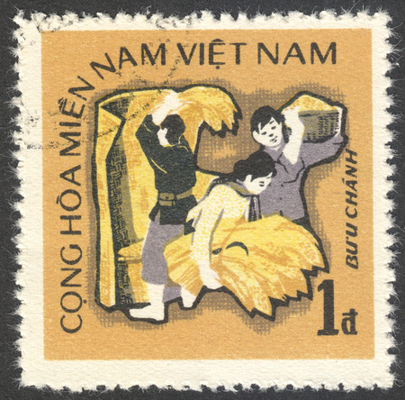 timbre: MOSCOW, RUSSIA - CIRCA AUGUST, 2016: a stamp printed in VIETCONG shows farmers, the series The 2nd Anniversary of Republic South Vietnam, circa 1971