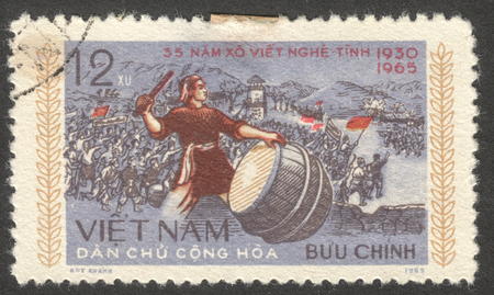 percussionist: MOSCOW, RUSSIA - CIRCA AUGUST, 2016: a stamp printed in VIETNAM shows a drummer, the series The 35th Anniversary of Nghe An and Ha Tinh Uprising, circa 1965 Editorial