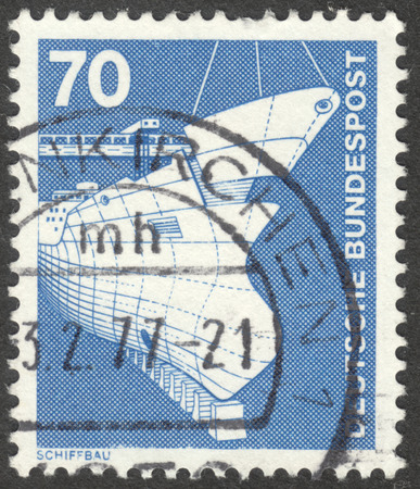 shipbuilding: MOSCOW, RUSSIA - CIRCA AUGUST, 2016: a stamp printed in GERMANY shows shipbuilding, the series Industry and Technology, circa 1975