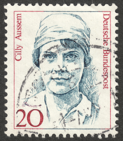 famous women: MOSCOW, RUSSIA - CIRCA AUGUST, 2016: a stamp printed in GERMANY shows a portrait of Cilly Aussem, the series Famous Women, circa 1986