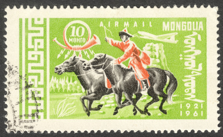 mongol: MOSCOW, RUSSIA - CIRCA AUGUST, 2016: a stamp printed in MONGOLIA shows a postman on Horse (Equus ferus caballus), the series The 40th Anniversary of Mongolian Postal Service, circa 1961