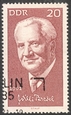ddr: MOSCOW, RUSSIA - CIRCA AUGUST, 2016: a stamp printed in DDR shows a portrait of  Willi Bredel, the series Famous Persons, circa 1971