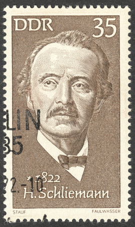 heinrich: MOSCOW, RUSSIA - CIRCA AUGUST, 2016: a stamp printed in DDR shows a portrait of  Heinrich Schliemann, the series Famous Persons, circa 1972