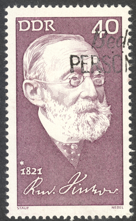postmarked: MOSCOW, RUSSIA - CIRCA AUGUST, 2016: a stamp printed in DDR shows a portrait of  Rudolf Virchow, the series The 150th Anniversary of the Birth of Rudolf Virchow, circa 1971
