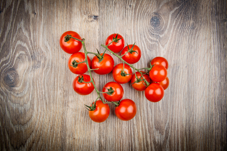 Bacground: Cherry tomatoes on the wooden bacground