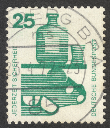 alcohol series: MOSCOW, RUSSIA - CIRCA SEPTEMBER, 2016: a stamp printed in GERMANY shows alcohol and an automobile, the series Prevent accidents, circa 1971