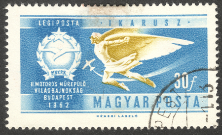 icarus: MOSCOW, RUSSIA - CIRCA SEPTEMBER, 2016: a stamp printed in HUNGARY shows Icarus Air, the series Aerobatics Championships - Aviation History, circa 1962
