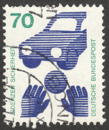 bundespost: MOSCOW, RUSSIA - CIRCA SEPTEMBER, 2016: a stamp printed in GERMANY shows a ball in front of a car (Child Road Safety), the series Prevent accidents, circa 1971 Editorial
