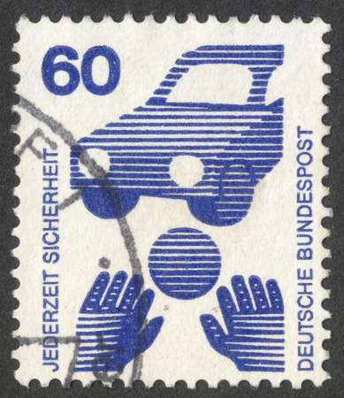 MOSCOW, RUSSIA - CIRCA SEPTEMBER, 2016: a stamp printed in GERMANY shows a ball in front of a car (Child Road Safety), the series Prevent accidents, circa 1971 Editorial