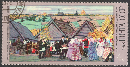 stempel: MOSCOW, RUSSIA - CIRCA OCTOBER, 2016: a post stamp printed in the USSR shows the painting Celebration in a Village, the series The 100th Anniversary of the Birth of B.M.Kustodiev, circa 1978