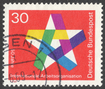 MOSCOW, RUSSIA - CIRCA OCTOBER, 2016: a post stamp printed in GERMANY, dedicated to the 50th anniversary of the International Labor Organization, circa 1969