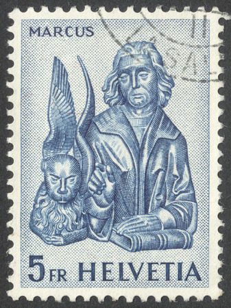 MOSCOW, RUSSIA - CIRCA OCTOBER, 2016: a post stamp printed in SWITZERLAND shows Saint Mark with the lion, the series Evangelists, circa 1961