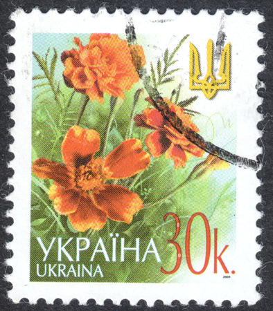 MOSCOW, RUSSIA - CIRCA OCTOBER, 2016: a post stamp printed in UKRAINE shows flowers and a trident, the Definitive Issue, circa 2003