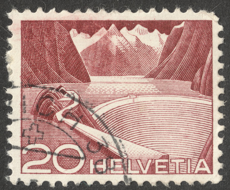 helvetica: MOSCOW, RUSSIA - CIRCA OCTOBER, 2016: a post stamp printed in SWITZERLAND shows Reservoir Grimsel, the series Engineering, circa 1949