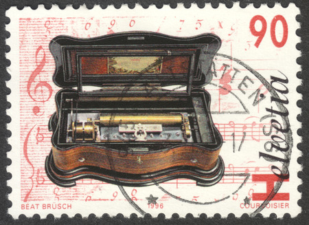eduard: MOSCOW, RUSSIA - CIRCA OCTOBER, 2016: a post stamp printed in SWITZERLAND shows Cylinder music box Mandoline-Basso-Piccolo, Eduard Jaccard, the series Mechanical music, circa 1996
