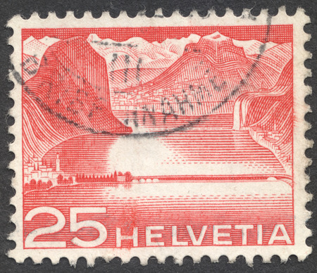 helvetia: MOSCOW, RUSSIA - CIRCA OCTOBER, 2016: a post stamp printed in SWITZERLAND shows Lake dam near Melide (Lake Lugano), the series Engineering, circa 1949