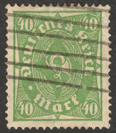 posthorn: MOSCOW, RUSSIA - CIRCA OCTOBER, 2016: a post stamp printed in GERMANY shows a posthorn, the series The Posthorn, circa 1923