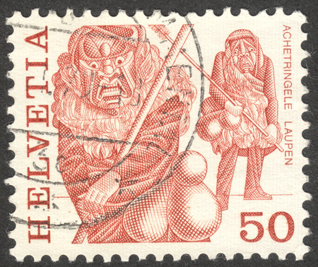 helvetia: MOSCOW, RUSSIA - CIRCA OCTOBER, 2016: a stamp printed in SWITZERLAND shows  traditional customs, the series Folk customs, circa 1982-1984 Editorial