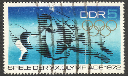 MOSCOW, RUSSIA - CIRCA NOVEMBER, 2016: a post stamp printed in the DDR shows a fighter, the series Olympic Games - Munich, Germany, circa 1972