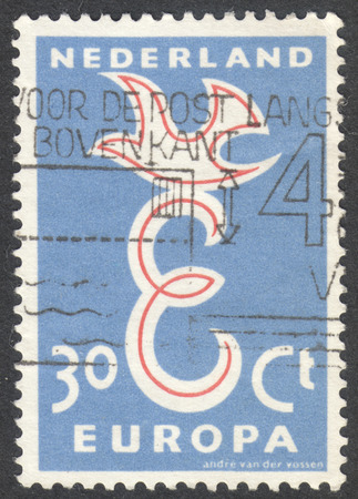 nederlan: MOSCOW, RUSSIA - CIRCA NOVEMBER, 2016: a post stamp printed in NETHERLANDS shows a dove, the series EUROPA Stamps, circa 1958