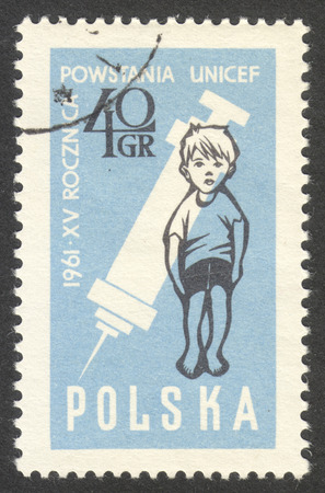 unicef: MOSCOW, RUSSIA - CIRCA NOVEMBER, 2016: a post stamp printed in POLAND shows  a child and a syringe, the series The 15th Anniversary of UNICEF, circa 1961 Editoriali