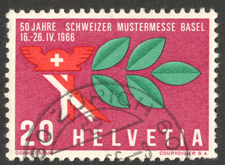 MOSCOW, RUSSIA - CIRCA NOVEMBER, 2016: a post stamp printed in SWITZERLAND shows a Mercury hat and laurel branch, dedicated to the Swiss Sample Fair, circa 1966
