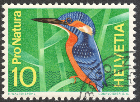 MOSCOW, RUSSIA - CIRCA DECEMBER, 2016: a post stamp printed in SWITZERLAND shows Common Kingfisher (Alcedo atthis) bird, the series Nature Conservation, circa 1966