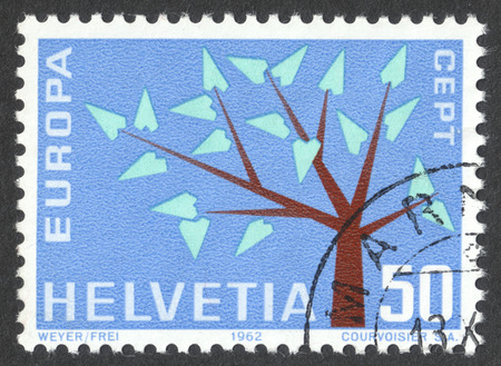 MOSCOW, RUSSIA - CIRCA DECEMBER, 2016: a post stamp printed in SWITZERLAND shows a stylised tree with 19 leaves, the series Europa (C.E.P.T.), circa 1962
