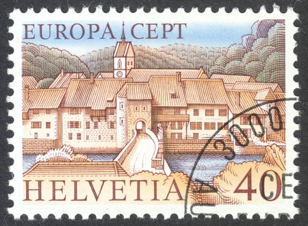 MOSCOW, RUSSIA - CIRCA DECEMBER, 2016: a post stamp printed in SWITZERLAND shows St.-Ursanne, Jura, the series Europa (C.E.P.T.), circa 1977 Editorial