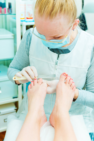 Photo of pedicure procedure in process photo