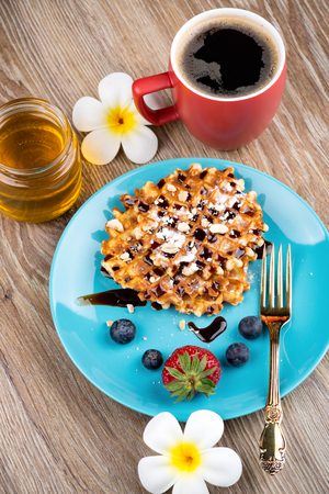 Photo of waffles with berries on wooden background Stock Photo